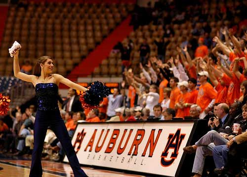 Auburn cheerleader throws t-shirt to fans