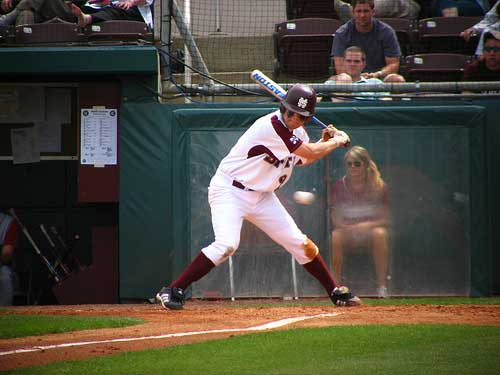 MSU batter watches baseball cross the plate