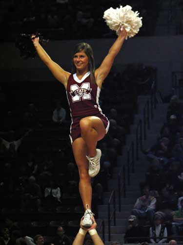 Bulldog cheerleader flips high in the air
