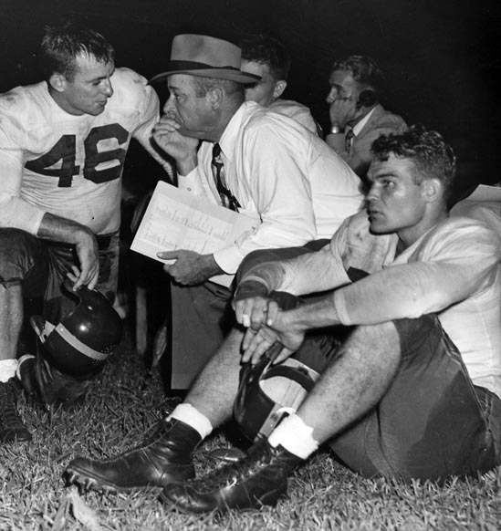 Chuck Hunsinger (#46) with Florida Coach Raymond