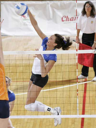 Kentucky womens volleyball player spikes over Tennessee