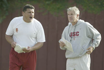 Ed Orgeron with Pete Carroll
