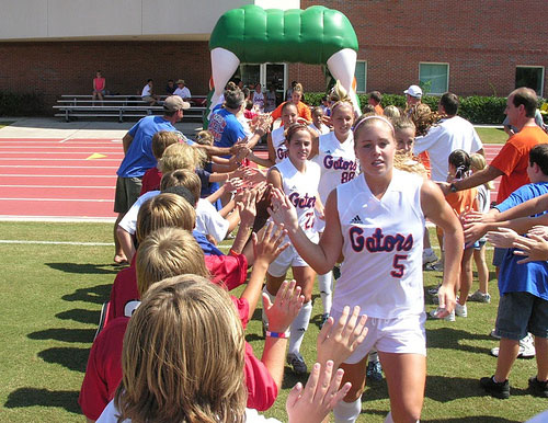 Florida Gators fans greet soccer players as they run through Gator Tunnel before game