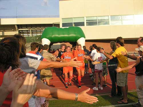 Florida Gators soccer team go through the Gator Tunnel