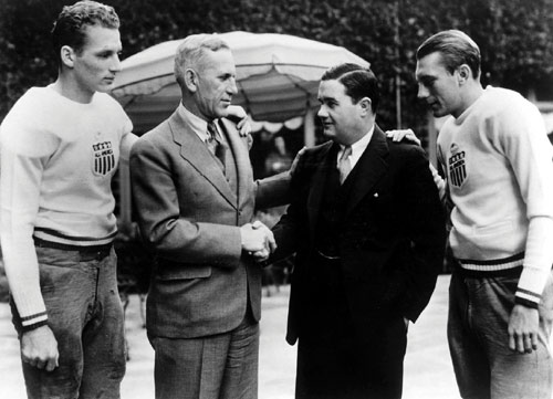 Alabama's football coach Frank Thomas shakes hands with USC coach Howard Jones before the 1935 Rose Bowl.