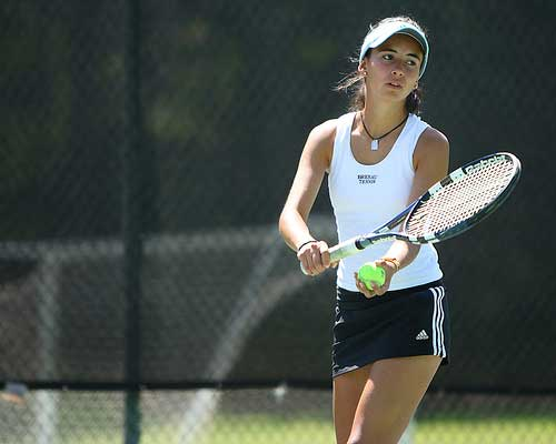 Lady Bulldog prepares for tennis serve