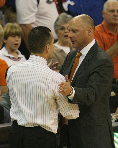 Auburn basketball coach jeff lebo greets florida's billy donovan before the game