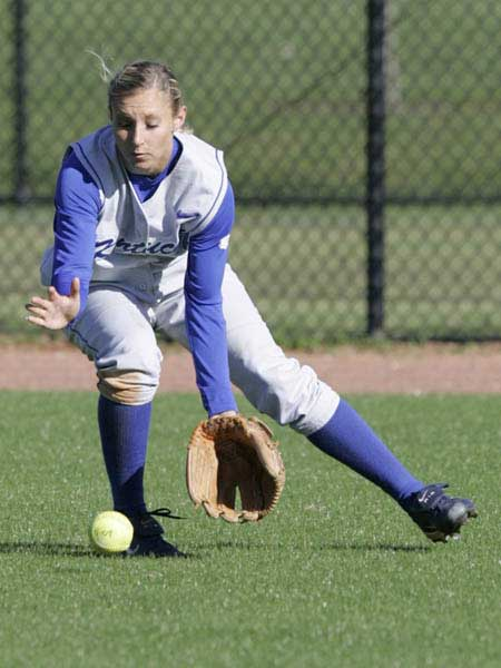 Kentucky softball player fields the ball