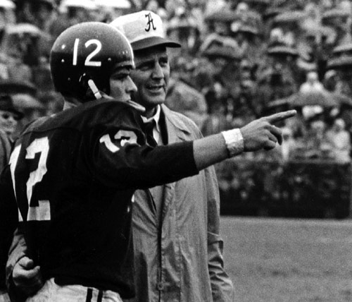 Pat Trammel talking to Bear Bryant on the sidelines in during the great 1961