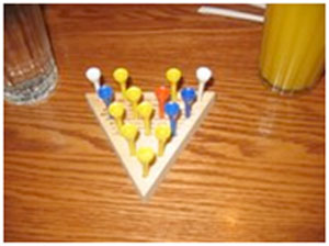 cracker barrel peg game how to win