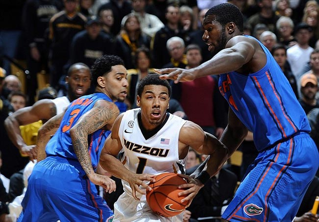Missouri Tigers guard Phil Pressey tries to get past