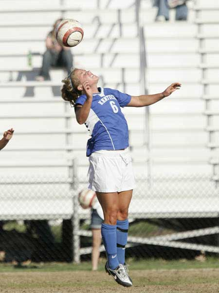 UK soccer player heads the ball