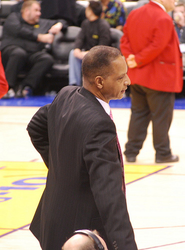 Trent johnson walks to scorers table
