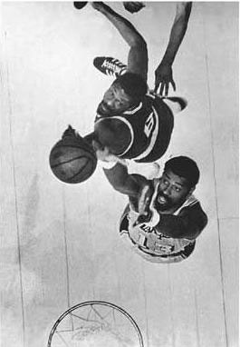 Wilt Chamberlain and Bill Russel battle for rebound in 1972