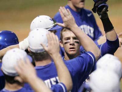 Kentucky baseball players give high five's after home run