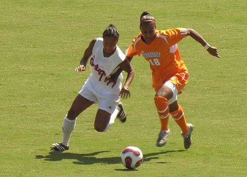 Florida's Ameera Abdullah battles Tennessee's Erica Griffin for control of the soccer ball