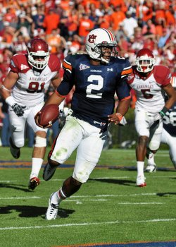 Cam Newton runs the ball in Arkansas game